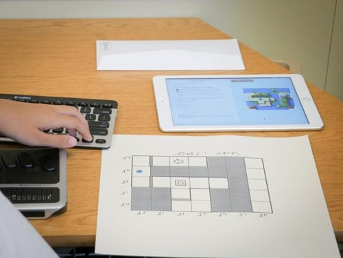 Image shows an iPad, refreshable braille display, and tactile diagram of the Swift Playground app.