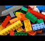 Photo shows a close-up of a pile of LEGO bricks
